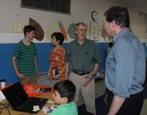 Local nonprofits, many with summer programs for kids, such as Building Bridges, Building Boats, headed by David Hardy, center, had informational tables at Discovery Night.