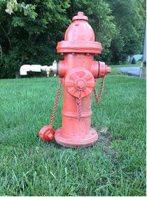 A hydrant with a reducer fitting and valve allowing one-inch flow, as opposed to the 2.5 inch opening normally utilized in a full-hydrant flush.