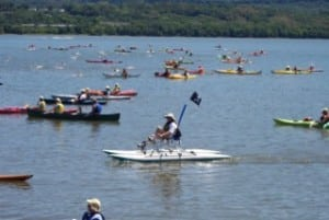 Kayakers escort swimmers across the Hudson during a previous running of the Great Newburgh to Beacon Hudson River Swim. (Photo by Michelle Marcus)