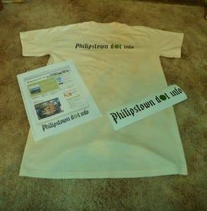 VisitorstothePhilipstowndotinfoofficeonJuly4,2010,receivedacopyofthewebsitehomepage,bumperstickerandT-shirt. PhotobyL.S.Armstrong