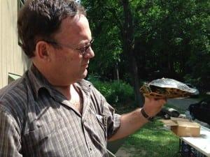 Professor Louis du Preez holds a painted turtle. (Photo by P. Doan)