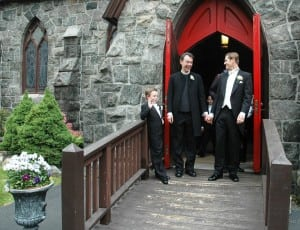 Accompanied by Senan Scott-Hamblen, Father Shane Scott-Hamblen and Steven Lukaj leave St. Mary's Episcopal Church on May 18, 2013, after their wedding. (File photo by Liz Schevtchuk Armstrong)
