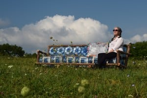 "Cold Spring artist Cassandra Saulter enjoys the view from her entry, ""Couch on the Farm"", part of ""Farm Project 2015"" at Saunders Farm in Garrison. (Photo by M. Turton)"