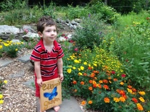 Edison Ford in his butterfly garden, a gift for his third birthday (Photo by P. Doan)