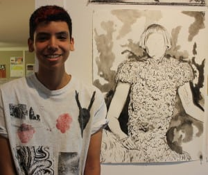 Artist Bradley Camacho Delgado, with his Lady Gaga in Ink, exhibited at the Garrison Art Center's Summer Arts Institute show; photo by A. Rooney