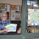 Harry Fadde distributes the Cold Spring Vistors' Map at the Chamber of Commerce information booth on Main Street. (Photo by Michael Turton)