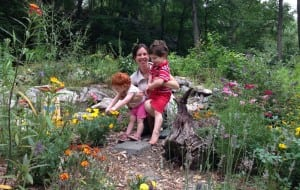 Krystal Ford with her son, Edison, and daughter, Lilly, in their butterfly garden