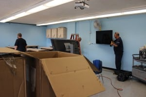 Members of Haldane's custodial crew in August install screens and furniture in the school's second  Maker Space. (Photo by A. Rooney)
