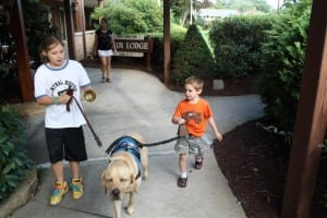 Nicky Mitrione (right), with his Guiding Eyes dog, Kelso.  They have been together for two years now.  (Photo courtesy of Guiding Eyes for the Blind)