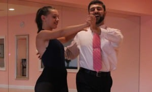 Yuriy Herhel teaches first-time ballroom dance student Lucy Austin the basics. (Photo by A. Rooney)