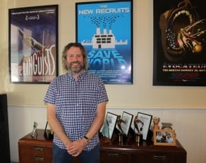 Ironbound Films' Daniel Miller, pictured in front of posters for several of his company's documentaries. (Photo by A. Rooney)
