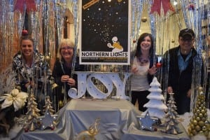 Staff at the Hudson Valley Shakespeare Festival show off their holiday window display.