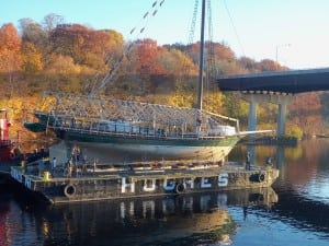 The Clearwater was hoisted onto a barge in Albany, then taken to Kingston for repairs. (Photo provided)
