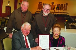 The Rev. James Loughran, vicar general and the Very Rev. Brian F. Terry, minister general, with John J. Conheeney and Mary Higgins Clark Conheeney (photo provided)