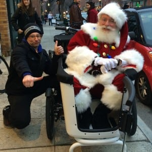Jon Miles of Peoples Bicycle delivered Santa in style to the Beacon tree lighting (photo provided)