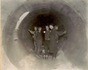 New York City engineers inspect the mortar lining inside the Catskill Aqueduct in Putnam County in 1923 (Photo courtesy New York City DEP)