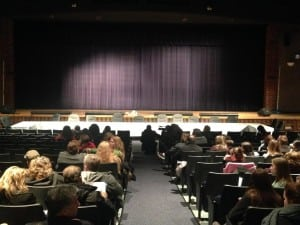 Parents fill the seats on Jan. 11 facing the empty chairs set out for board members at the front of the auditorium. (Photo by A. McKible/courtesy Advocates for Beacon Schools)