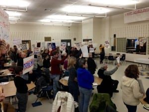 Beacon parents gathered in the high school cafeteria with signs of protest outside a closed meeting of the Beacon School Board on Jan. 14 (photo by J. Simms)