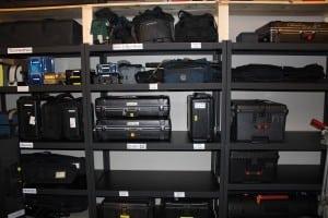 ShelvesatTheCineHub,filledwithrentalequipment,includingteleprompters,monitors,rainhoods,tripodsandcameras.(PhotobyA.Rooney)