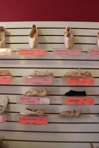 Pointe shoes and ballet slippers, along with tap, character and other dance shoes, line the walls at Dance Bag. (Photo by A. Rooney)