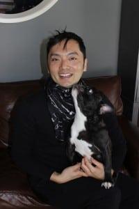TextiledesignerSuguruMiyagi,wearingoneofhisowncreations,accessorizedbyhiscolor-coordinatedFrenchbulldog.(PhotobyA.Rooney)