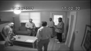 Insurveillancecamerafootage,FBIinformantShahedHussain,shownwithhisbackturned.