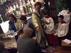 FatherShaneScott-Hamblenofferscommunion(photoprovided)