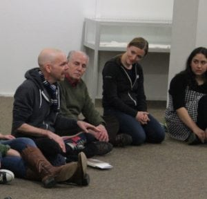 JohnPlummer(center)talksaboutthelogisticsoftheproduction(photobyA.Rooney)