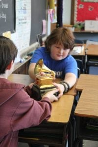 Haldane fifth-grader Max Watman checks out the actual Grammy award belonging to Leo Sacks at Arts Alive!  (Photo by Katie Bissinger)