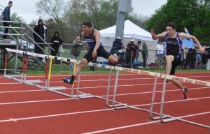David Adams of Beacon High School on his way to winning the 400m hurdles in 56.40 at the Somers Lion Club Invitational on May 7 (Photo by Peter Farrell)