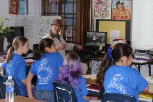 Leo Sacks using new technology to bring home old footage to fifth-grade Haldane students at Arts Alive! (Photo by A. Rooney)