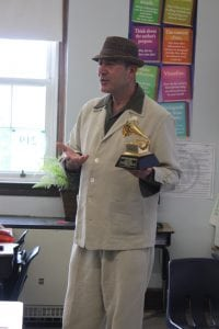 Leo Sacks, holding his own Grammy award, during the class he taught at Haldane's Arts Alive! (Photo by Katie Bissinger)