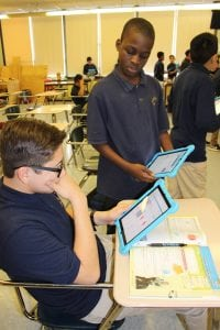"""SanMiguelAcademystudentscompare""""notes""""ontheirtablets.(PhotobyA.Rooney)"""