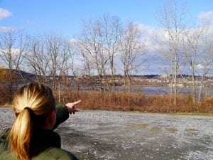 Beacon resident Lisa Gallina points toward the Hudson River vista she believes could be lost to development within the linkage zone. (Photo by J. Simms)