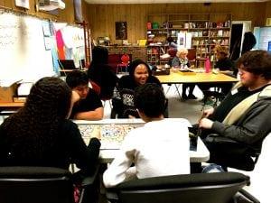 IanGroombridgeassistsstudentsatPeekskillHighSchool'sSuccessAcademyastheyanalyzeboardgames(photoprovided)