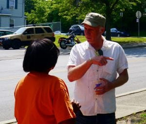 George Mansfield speaking with a constituent (photo by J. Simms)
