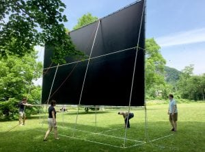 Volunteers set up the new screen in a trial run for the first Cold Spring Film Society movie on June 25 (photo provided)
