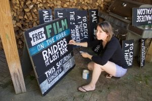 Jennifer Zwarich putting finishing touches on a movie sign. (Photo by K.E. Foley)