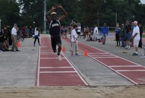 Beacon Bulldog Rayvon Grey lands a distance of 47-03.75 in the Triple Jump at the N.Y. State Qualifiers at White Plains High School on June 3. Grey will be heading to the N.Y. State Championships in Syracuse on June 10. (Photo by Peter Farrell)