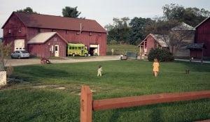 ChildrenplayinginafieldnearCommonGroundFarm'sbarn.(PhotobyDanaDevine-O'Malley)