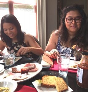 Two tour guests enjoy their tastings at a Rhinebeck restaurant. (Photo by Jennifer Brizzi)