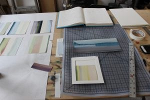 "Watercolor""thirds"",tape,aruler:partofastilllifeatSusanEnglish'sstudio.(PhotobyA.Rooney)"