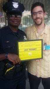 Ori Olon, right, presenting a Joy Permit to the Cleveland Police Department (photo provided)