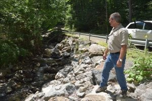 Erosion protection must be rebuilt along this stream on the shoulder of South Mountain Pass Road (Photo by M. Turton)
