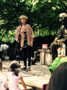 Judith Heineman performing at the statue of the Hans Christian Andersen in Central Park (photo provided)