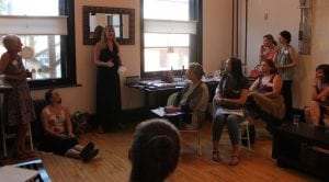 Katie Hellmuth Martin (center) speaks to the Hudson Valley Women in Business group about email marketing. The meet-up was held in Martin's new offices, from which she operates A Little Beacon Blog. (Photo by A. Rooney)