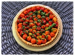Cherry Tomato Tart with Caramelized Shallots and Basil Vinaigrette (Photo by J. Dizney)