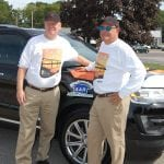 Robert Doyle and Rick Brownell in front of the Ford Explorer they will pilot on The Fireball Run (photo provided)