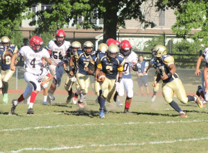 ... and is scooped up by Manny Garner (2), who returned it for the winning touchdown (Photos by Rem Dinio)