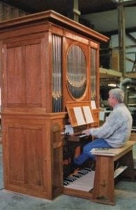 George Bozeman working on the organ (photo provided)